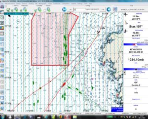 Cape Finistere Traffic Separation Zone. Great American IV is the red boat heading southwest. Green are ships entering the northbound lane as identified by AIS. Ships do not appear in the other lanes because the range of AIS is not long enough for us to see them. Green boat behind Great American IV, also heading Southwest, is Alan Roura, Swiss skipper for Vendée Globe.